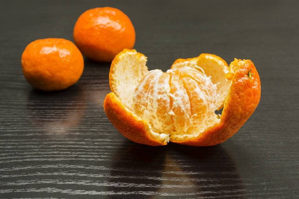 Removed peel from the ripe fruit of a sweet mandarin.