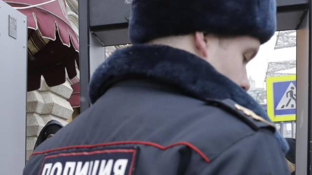 A man dressed as Father Frost, the Russian equivalent of Santa Claus, passes a police security check in central Moscow