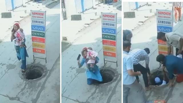 VIDEO Žena s djetetom upala u šaht usred ulice, telefonirala je