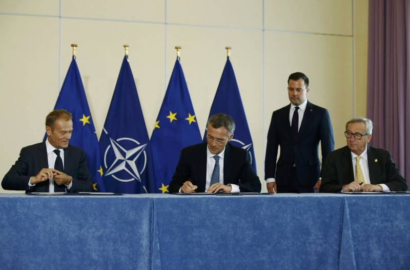 European Council President  Tusk, NATO Secretary-General Stoltenberg and European Commission President Juncker take part in a signing ceremony of EU-NATO Joint Declaration in Warsaw