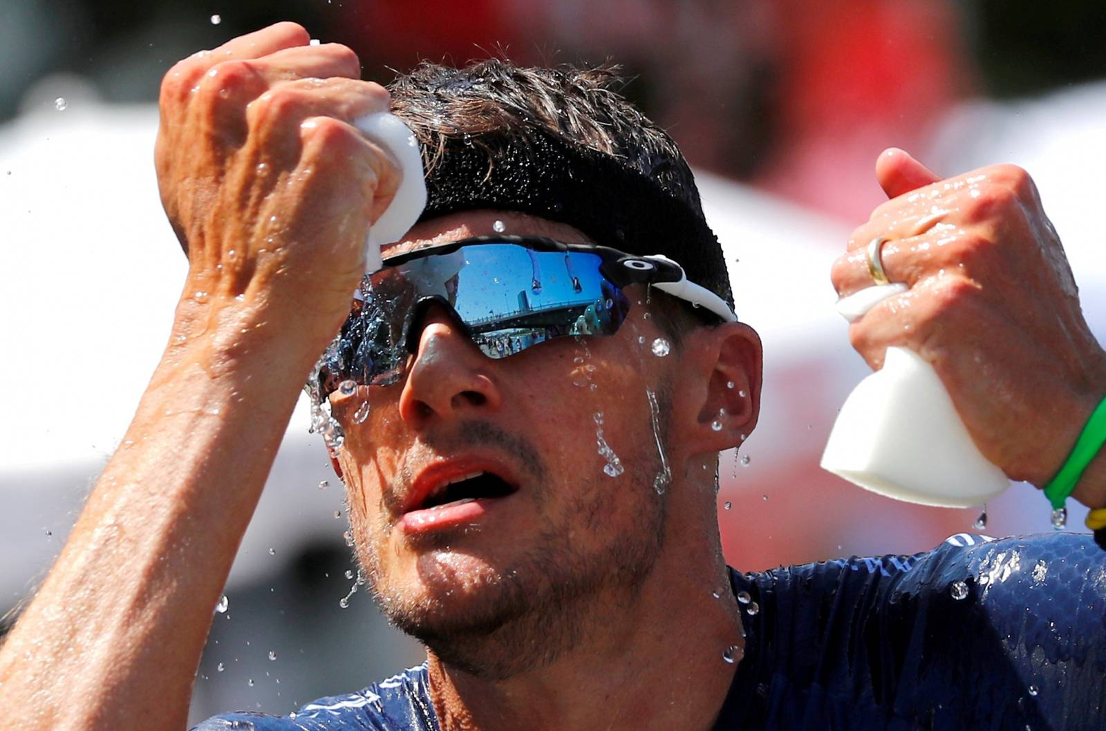 FILE PHOTO: Triathlete Jan Frodeno of Germany tries to cool down on his way to win the Ironman triathlon European Championships in Frankfurt
