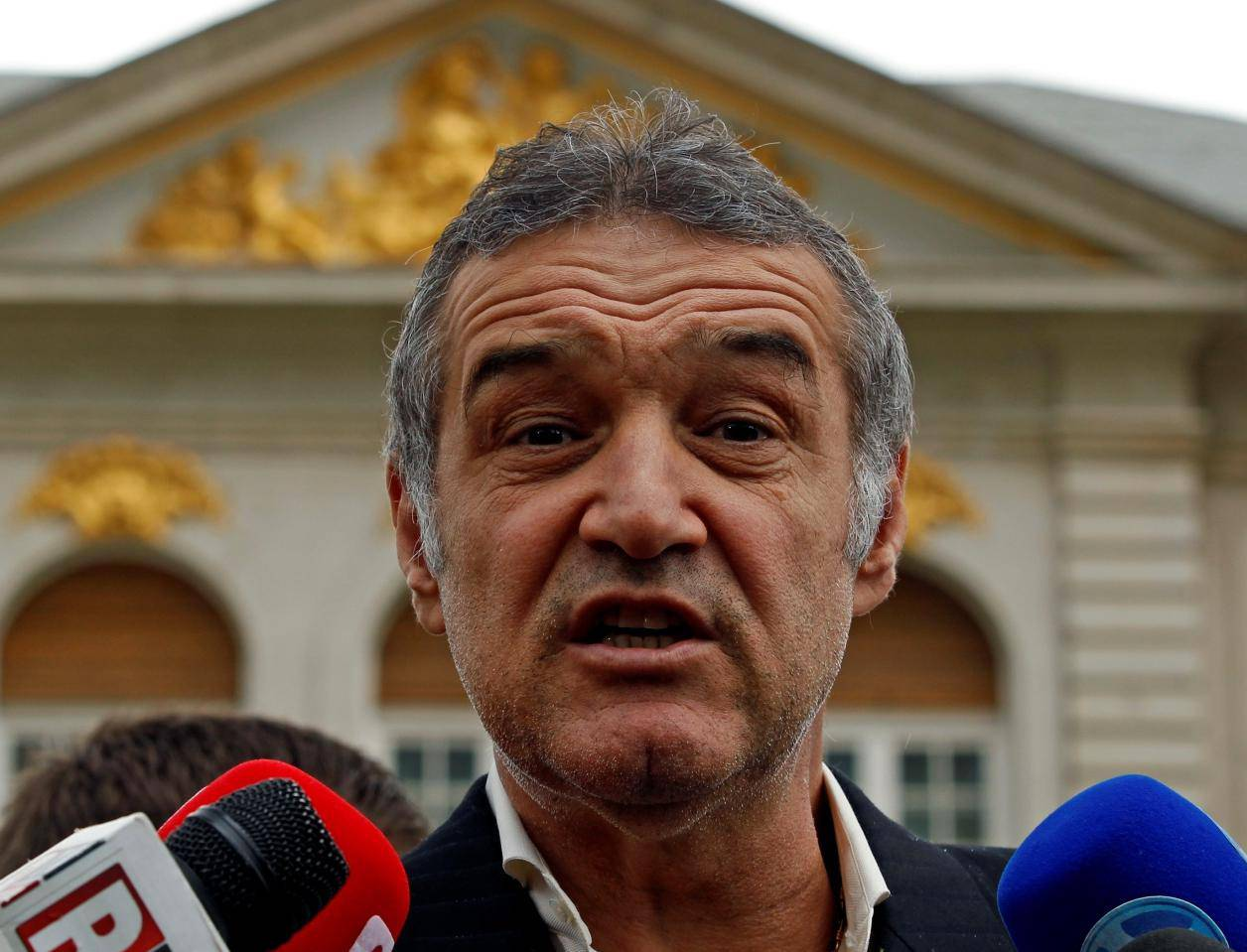 FILE PHOTO: Romanian lawmaker and soccer club owner George Becali  talks to the media in Bucharest