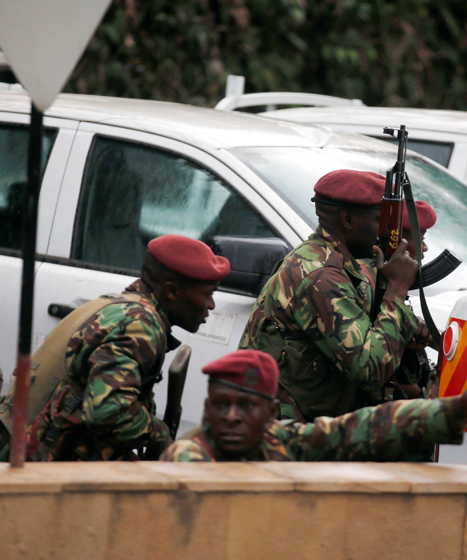 Members of security forces take positions at the scene where explosions and gunshots were heard at the Dusit hotel compound, in Nairobi