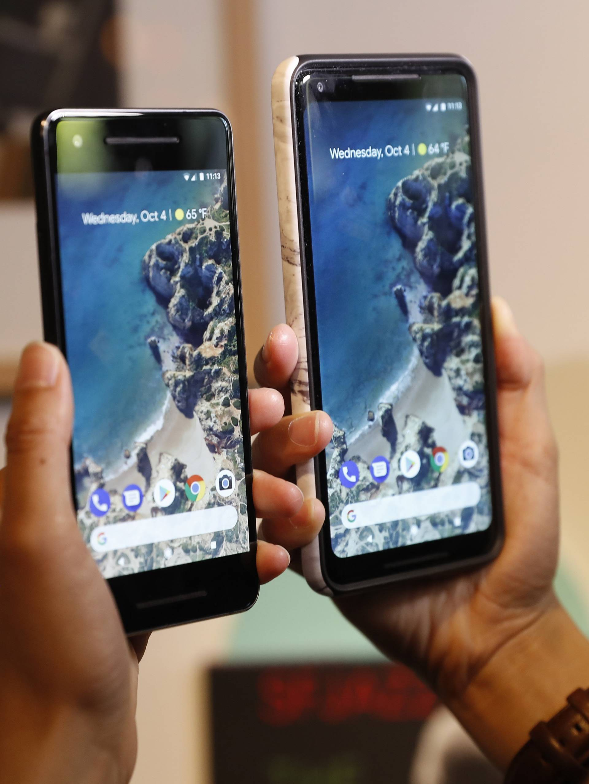 People compare Google phones during a launch event in San Francisco