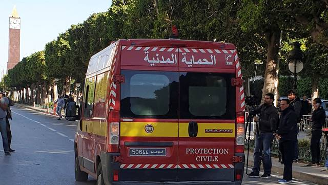 Civil protection vehicle drives near the site of an explosion in the center of the Tunisian capital Tunis