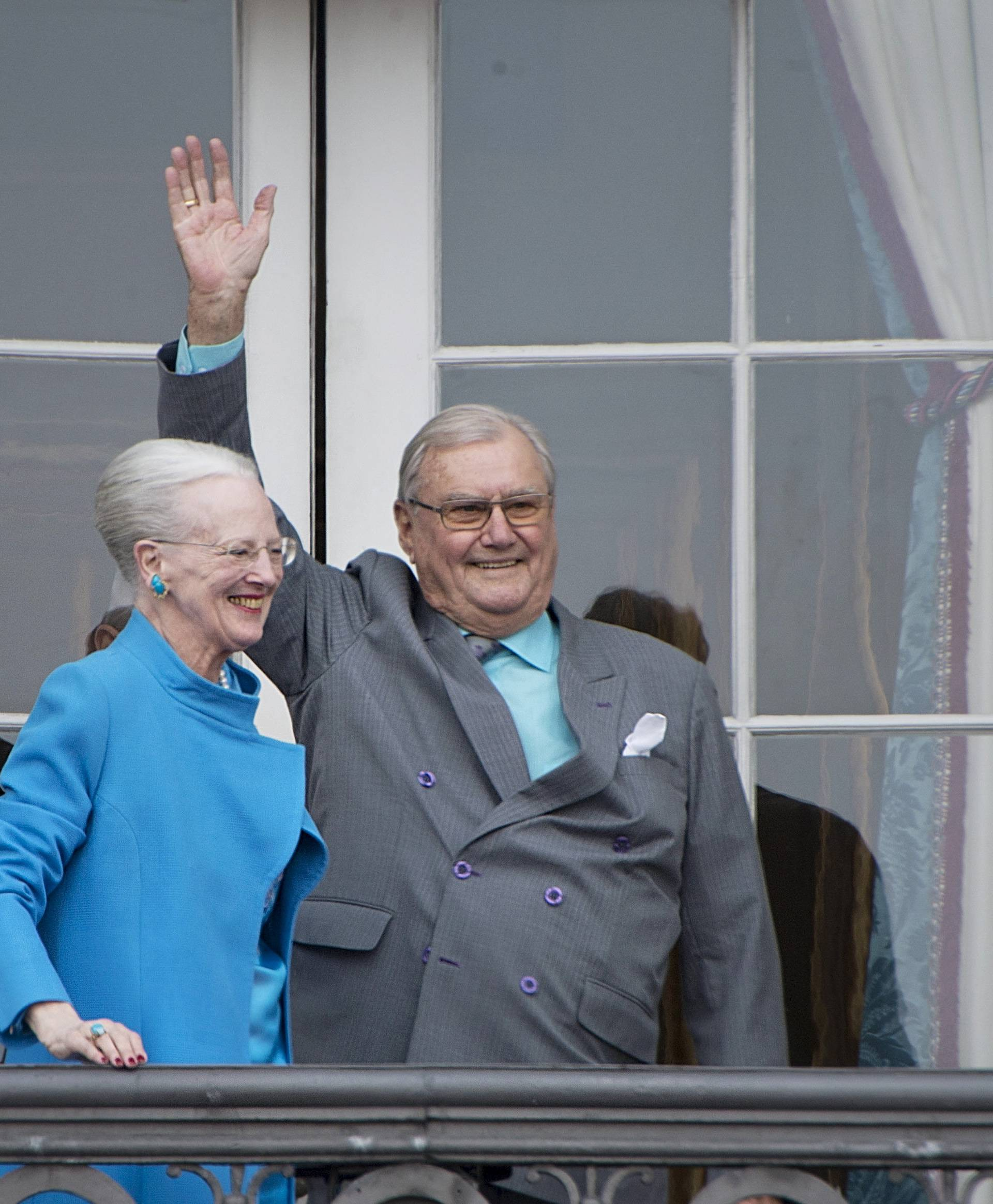 FILE PHOTO: Denmark's Queen Margrethe and Prince Henrik wave from the balcony during Queen Margrethe's 76th birthday celebration at Amalienborg Palace in Copenhagen