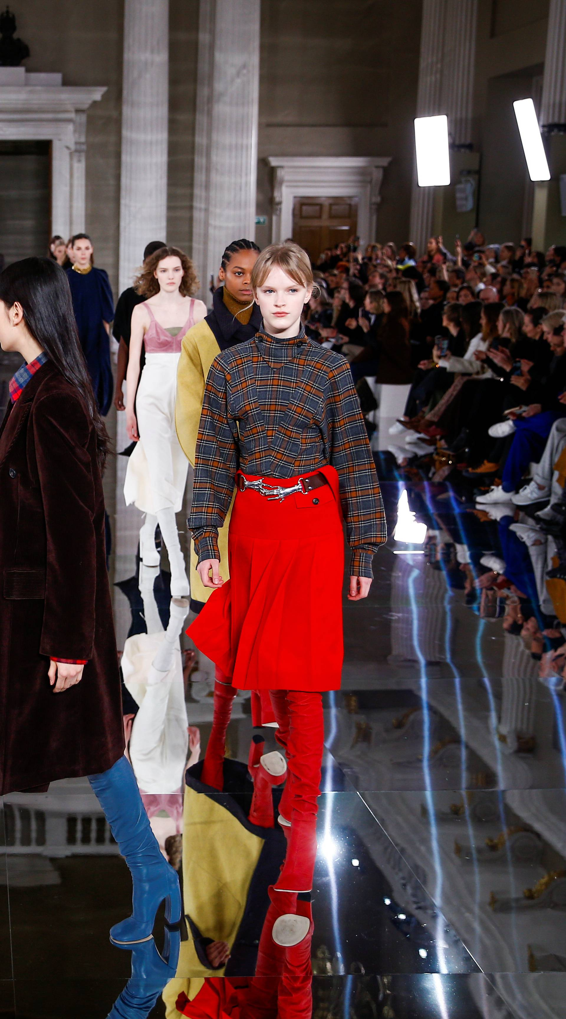 Models present creations at the Victoria Beckham catwalk show during London Fashion Week in London