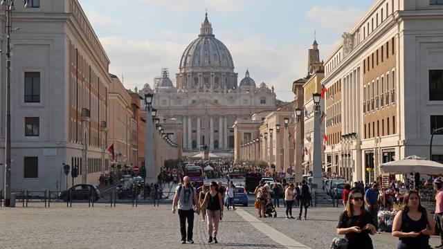 People walk the Via della Conciliazione leading to the Vatican City, in Rome