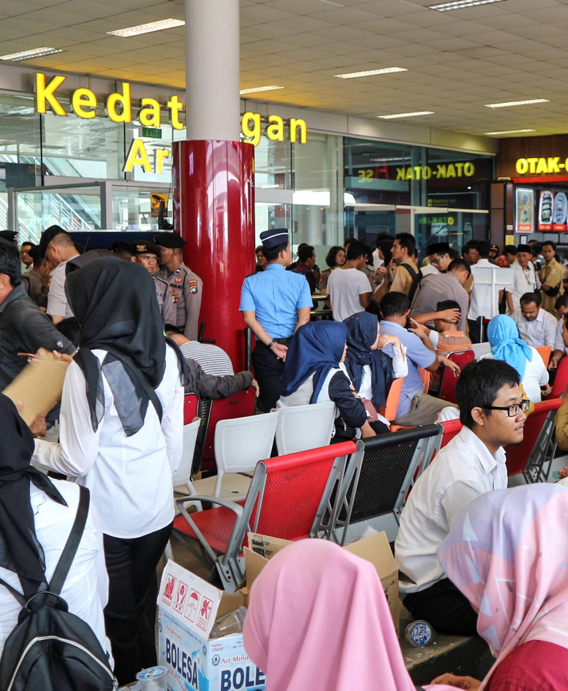 Relatives of passengers of the Lion Air plane that crashed into the sea are seen at Depati Amir airport in Pangkal Pinang, Belitung island