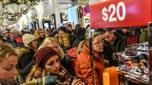 People shop during a Black Friday sales event at Macy's flagship store in New York City