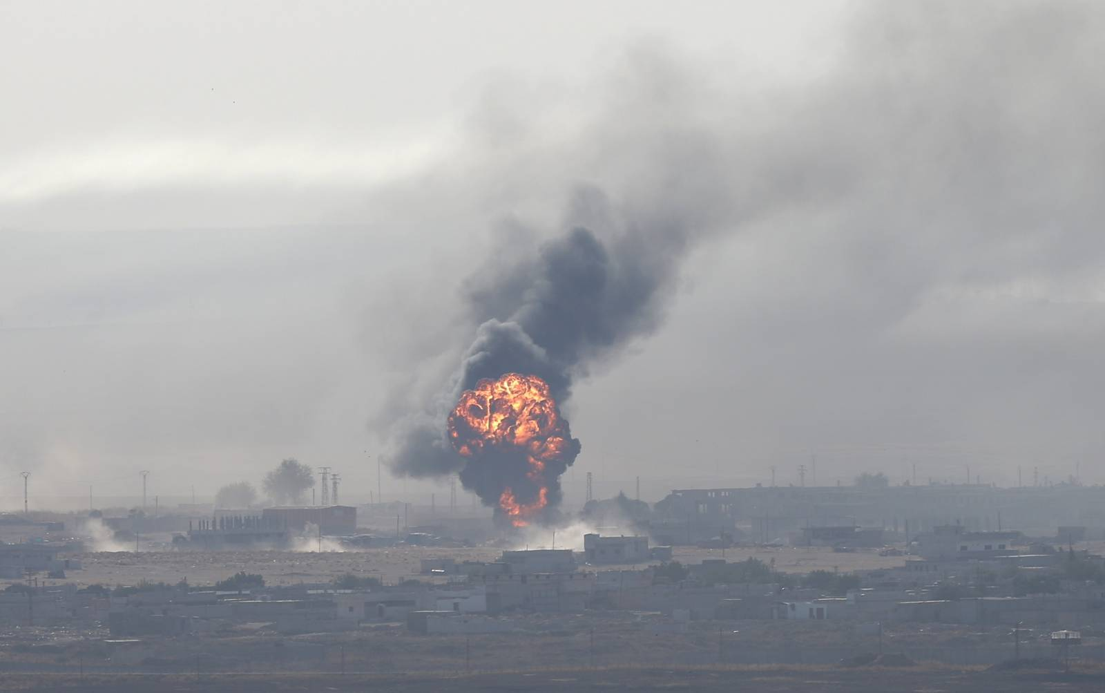 Explosion is seen over the Syrian town of Ras al-Ain as seen from the Turkish border town of Ceylanpinar