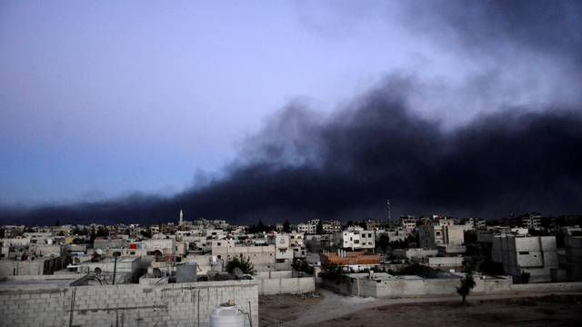 FILE PHOTO: Smoke rises into the sky from what activists said was Free Syrian Army fighters destroying a tank that belonged to forces loyal to Syria's President Bashar al-Assad in the Qaboun area, Eastern Ghouta