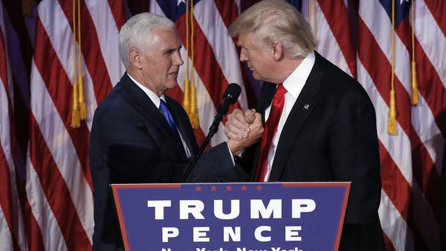 U.S. President-elect Donald Trump greets his running mate Mike Pence during his election night rally in Manhattan