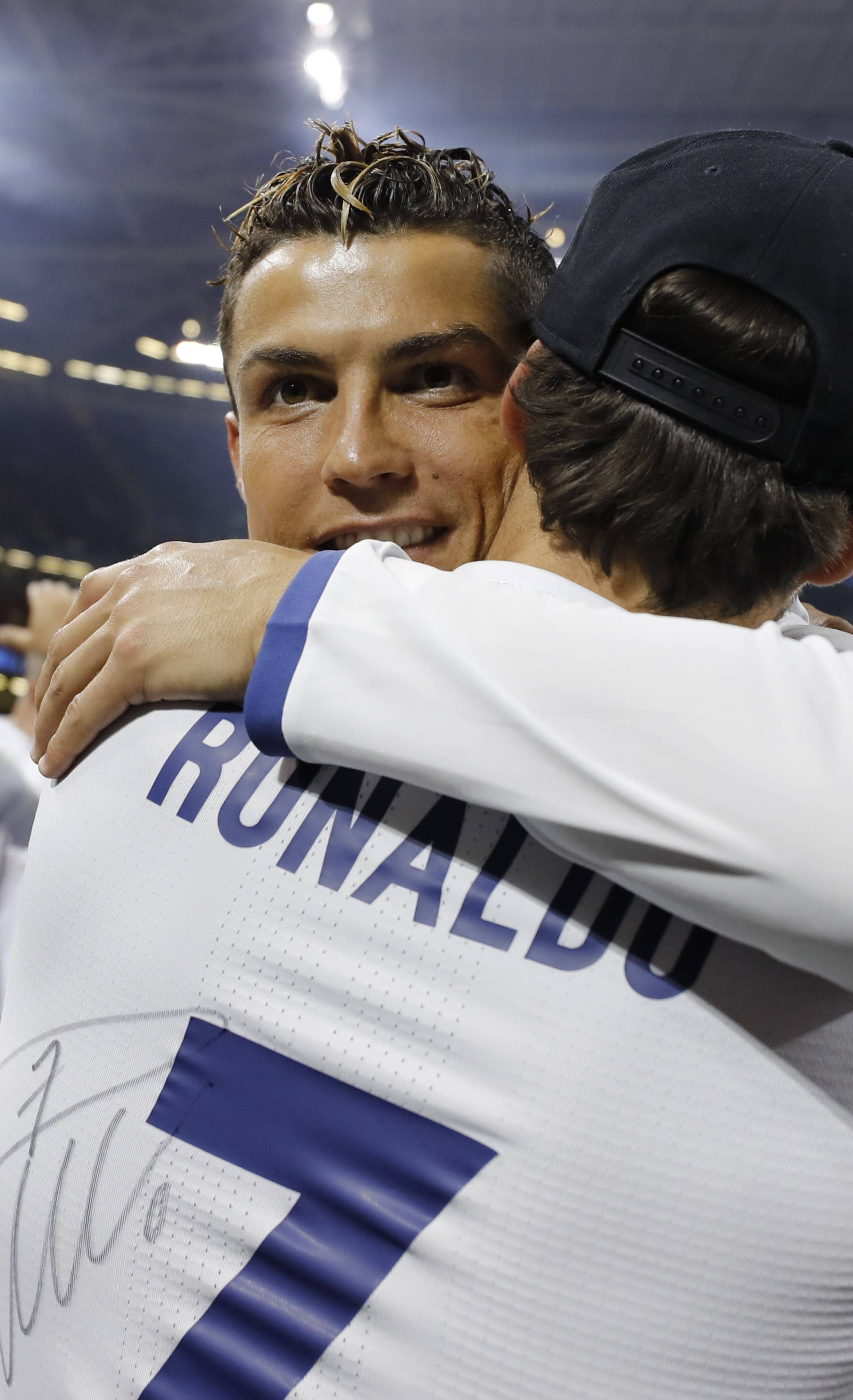 Real Madrid's Cristiano Ronaldo celebrates winning the UEFA Champions League Final with family