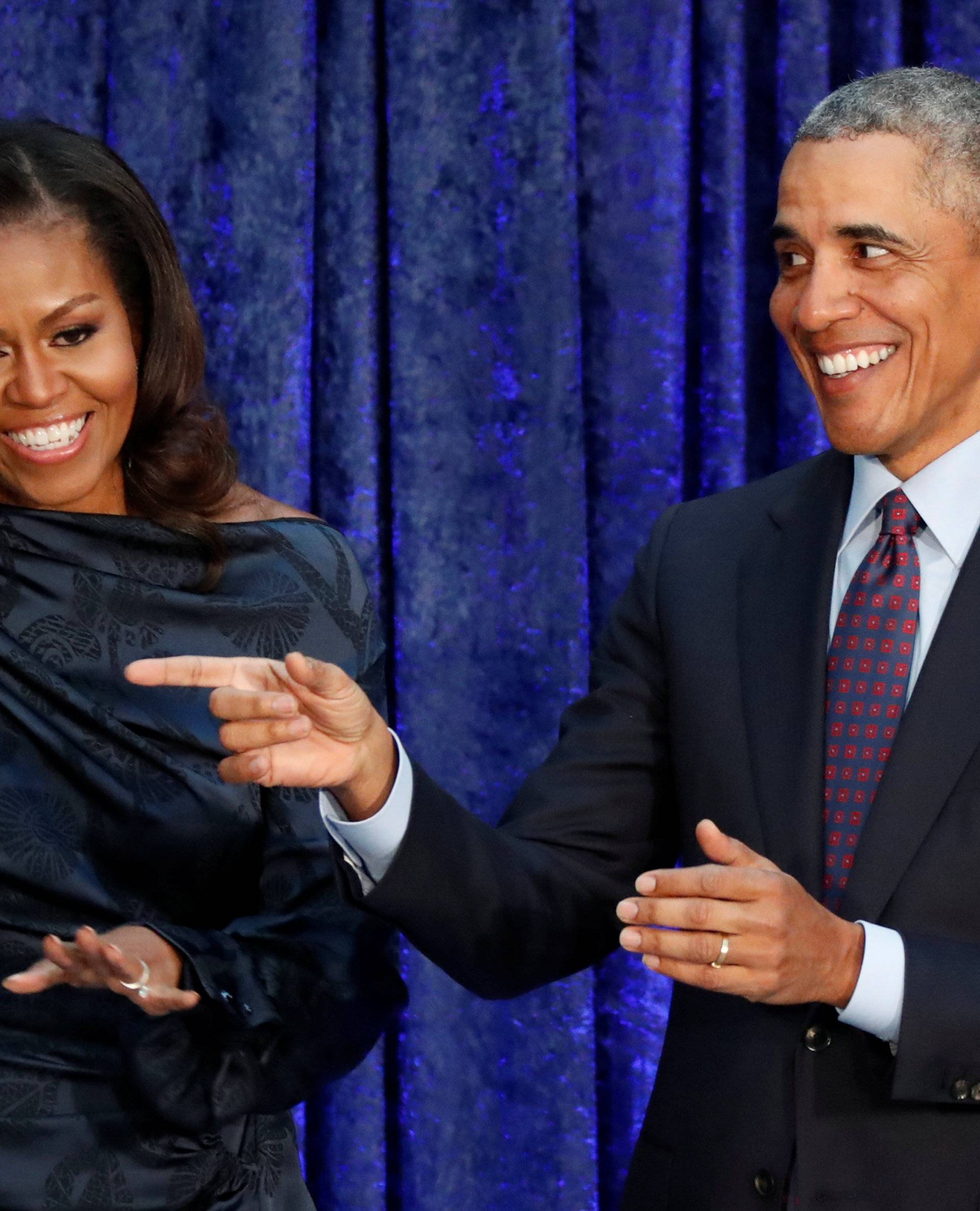 FILE PHOTO: Former U.S. President Obama and first lady Michelle Obama acknowledge guests during  portraits unveiling at the Smithsonian's National Portrait Gallery in Washington