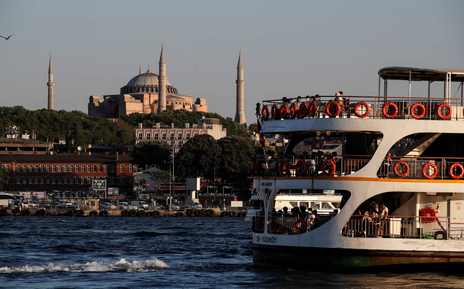 A ferry sails through the waters of Marmara sea as Hagia Sophia or Ayasofya-i Kebir Camii is seen in the background in Istanbul