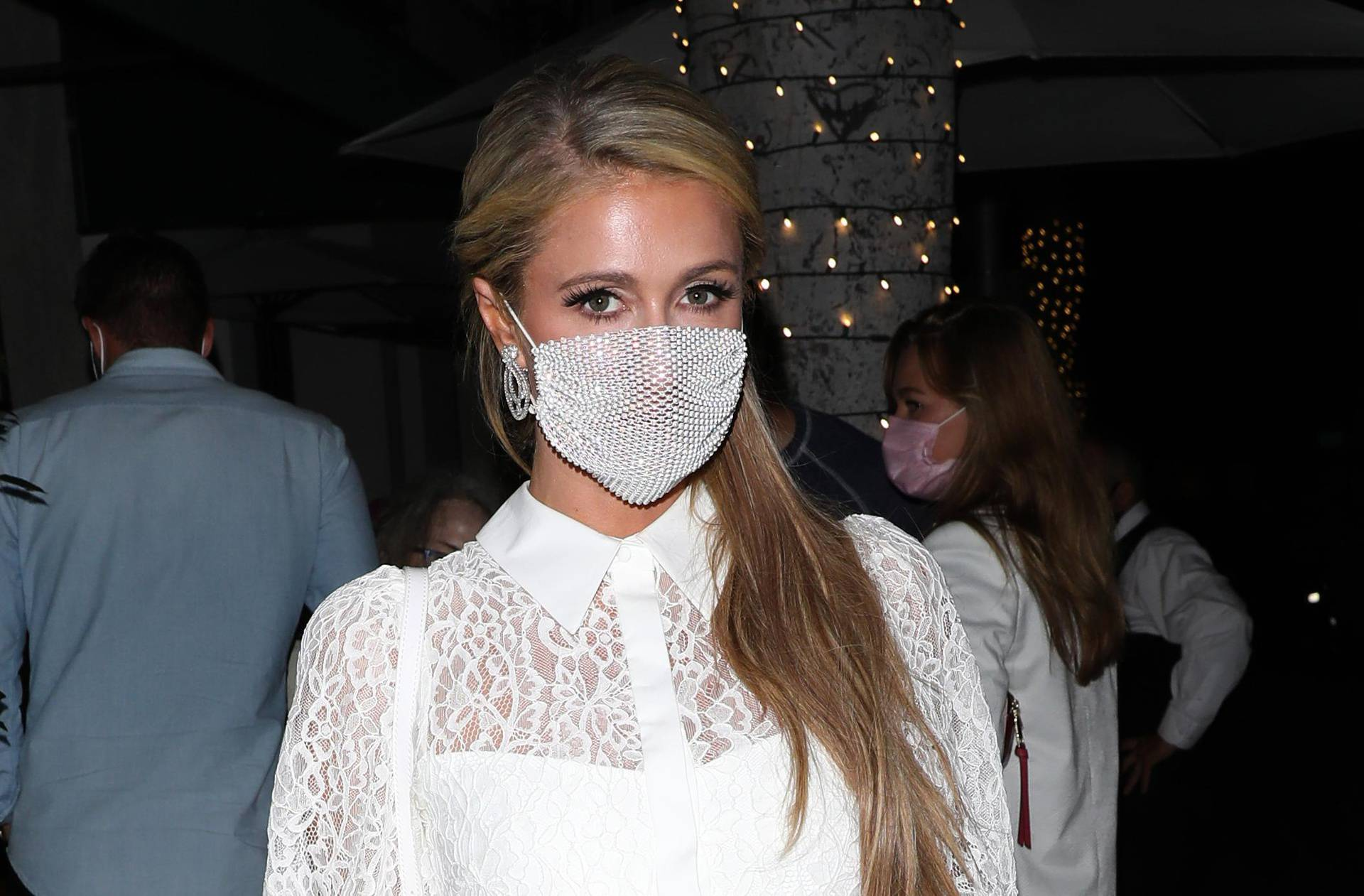 EXCLUSIVE: Paris Hilton stuns in a all white dress as she dines at Madeo restaurant with friends
