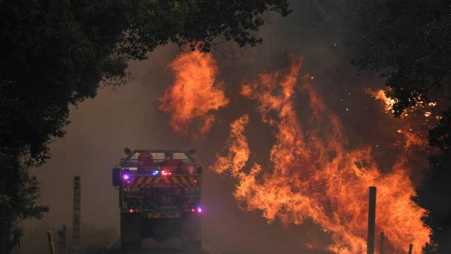 A fire truck is seen near a bushfire in Nana Glen