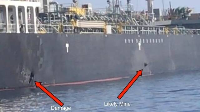 A picture released by U.S. Central Command shows damage from an explosion (L) and a likely limpet mine, on the hull of the civilian vessel M/V Kokuka Courageous in the Gulf of Oman