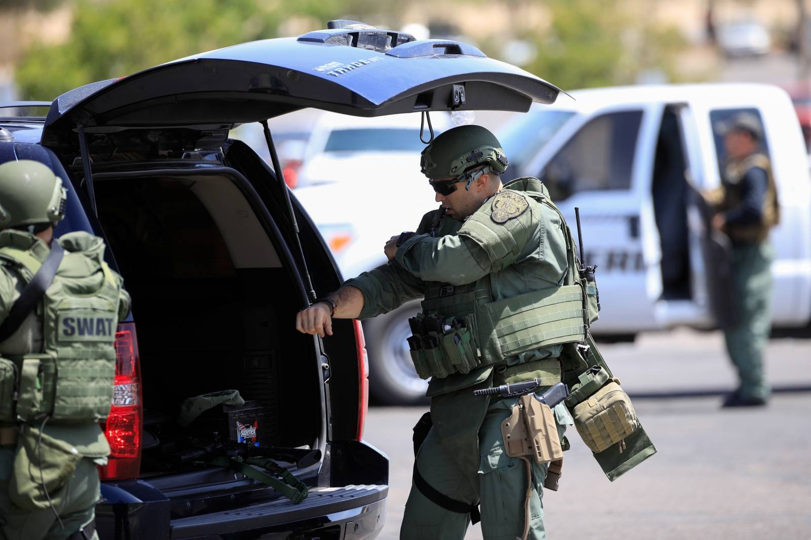 Police SWAT team members prepare after a mass shooting at a Walmart in El Paso