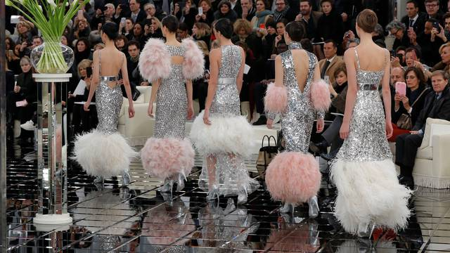 Models present creations by German designer Karl Lagerfeld as part of his Haute Couture Spring/Summer 2017 fashion show for Chanel in Paris