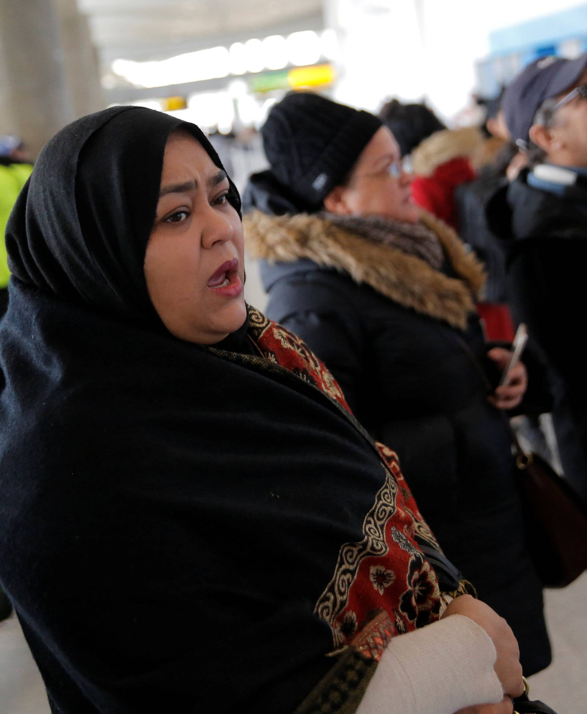 A woman waits for family to arrive at John F. Kennedy International Airport in Queens, New York, U.S.