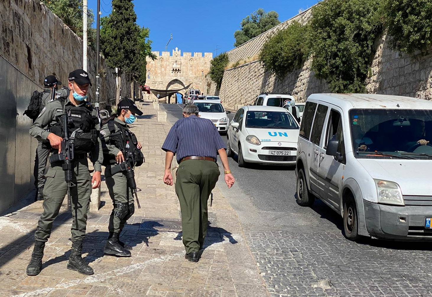 Israeli border police secure the area outside Jerusalem's Old City where officers fatally shot a man they believed was armed