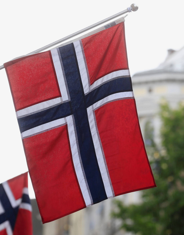 FILE PHOTO: Norwegian flags flutter at Karl Johans street in Oslo