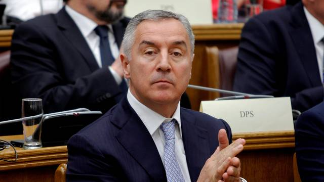 President of a ruling Democratic Party of Socialist (DPS), former prime minister and president of Montenegro, Milo Djukanovic applauds during a parliament discussion on NATO membership agreement in Cetinje
