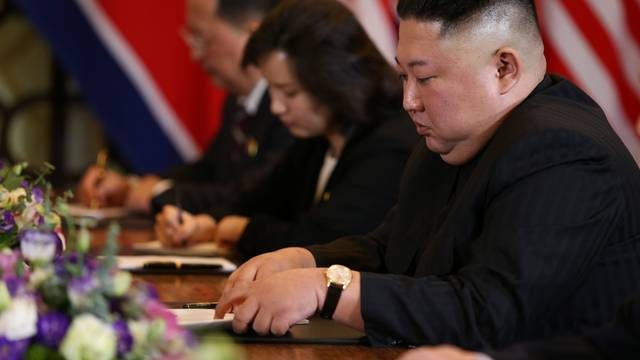 North Korea's leader Kim Jong Un attends the extended bilateral meeting in the Metropole hotel during the second North Korea-U.S. summit in Hanoi