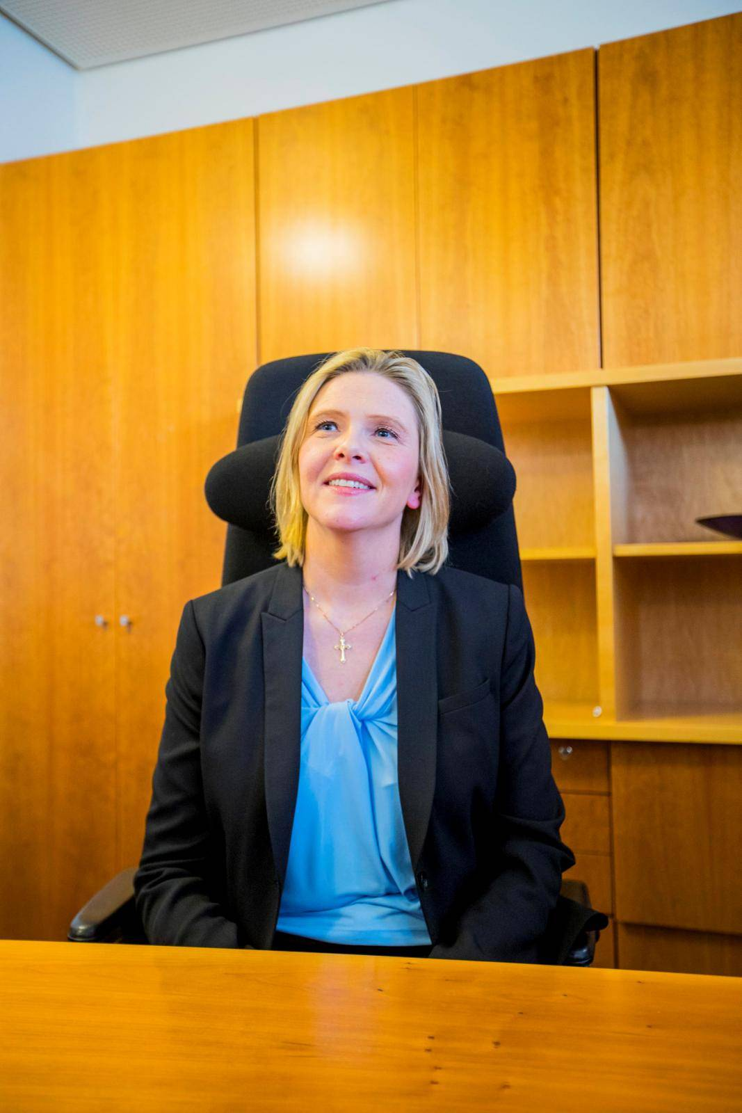 Sylvi Listhaug sits at the desk after she was introduced as the new Senior and Public Health Minister, in Oslo