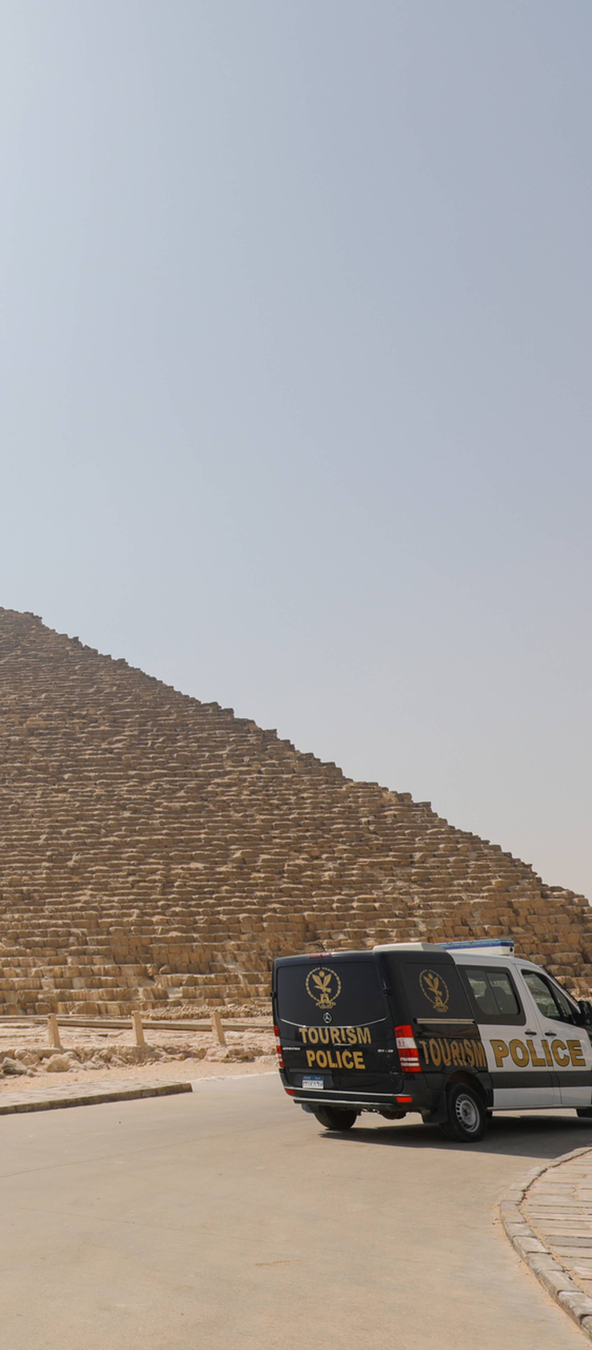 A police car is parked near the Great Pyramids, Giza, on the outskirts of Cairo, as the coronavirus disease (COVID-19) outbreak continues