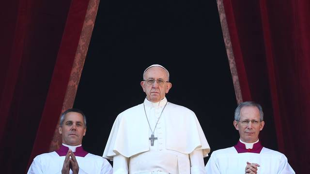 "Pope Francis leads the ""Urbi et Orbi"" message from the balcony overlooking St. Peter's Square at the Vatican"