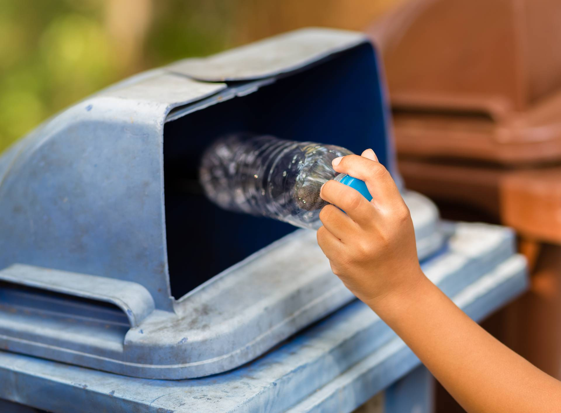 Child Drop the Plastic Bottle