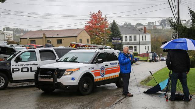 Police vehicles block off the road near the home of Pittsburgh synagogue shooting suspect Robert Bowers' home in Baldwin borough suburb of Pittsburgh