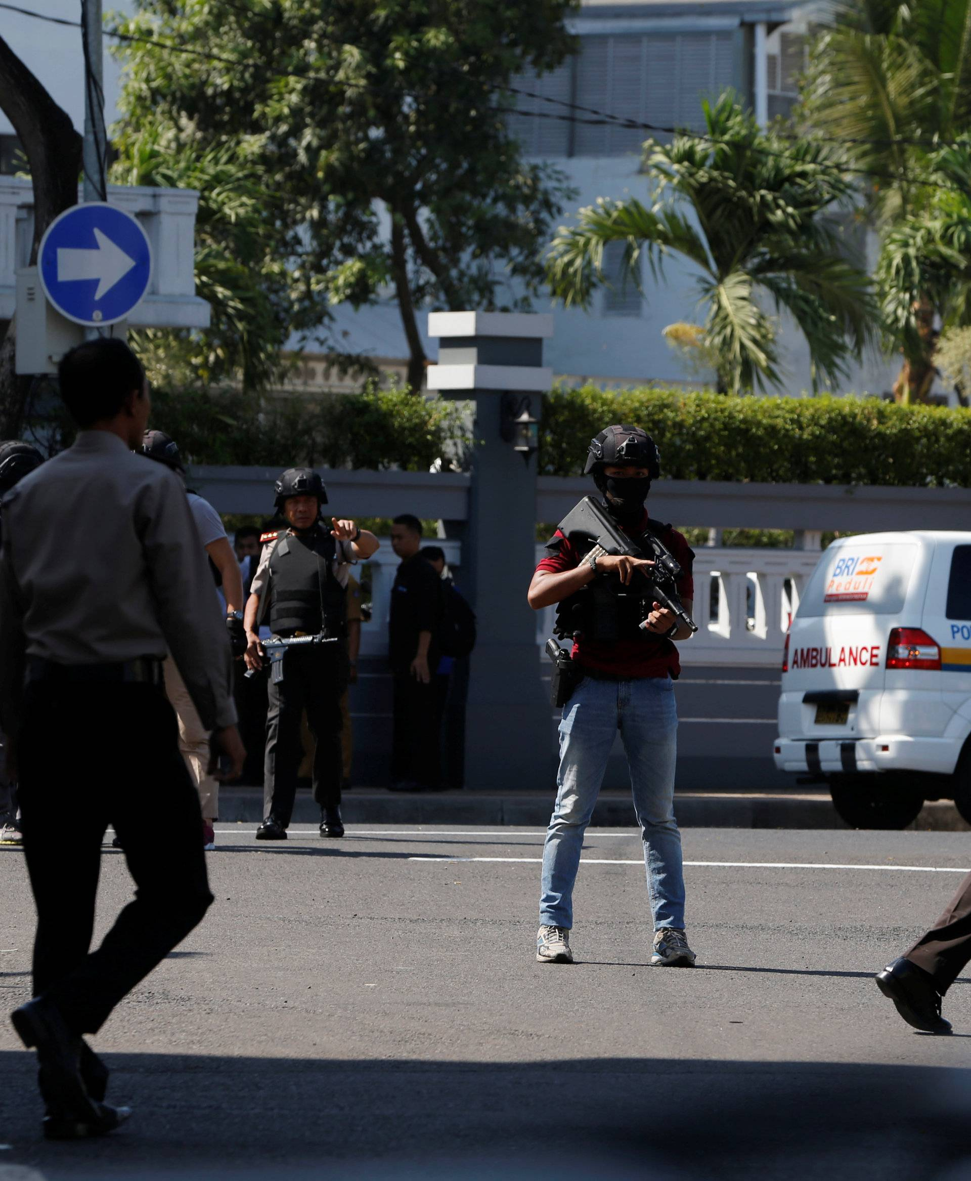 Anti-terror policemen stand guard following a bomb blast in front of a police office in Surabaya