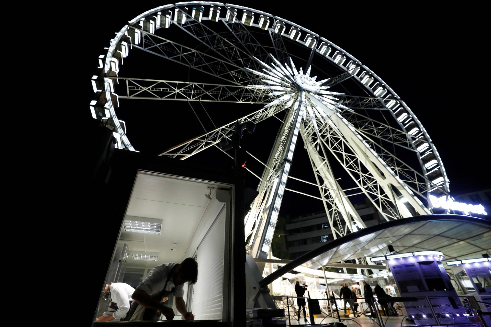 A chef prepares food as Michelin-starred restaurant Costes moves into the Budapest Eye ferris wheel during the coronavirus outbreak