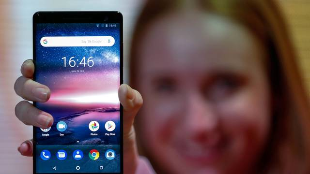 A woman holds the new Nokia 8 Sirocco during the Mobile World Congress in Barcelona