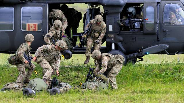 FILE PHOTO: U.S. army soldiers leave Black Hawk helicopter during Suwalki gap defence exercise in Mikyciai