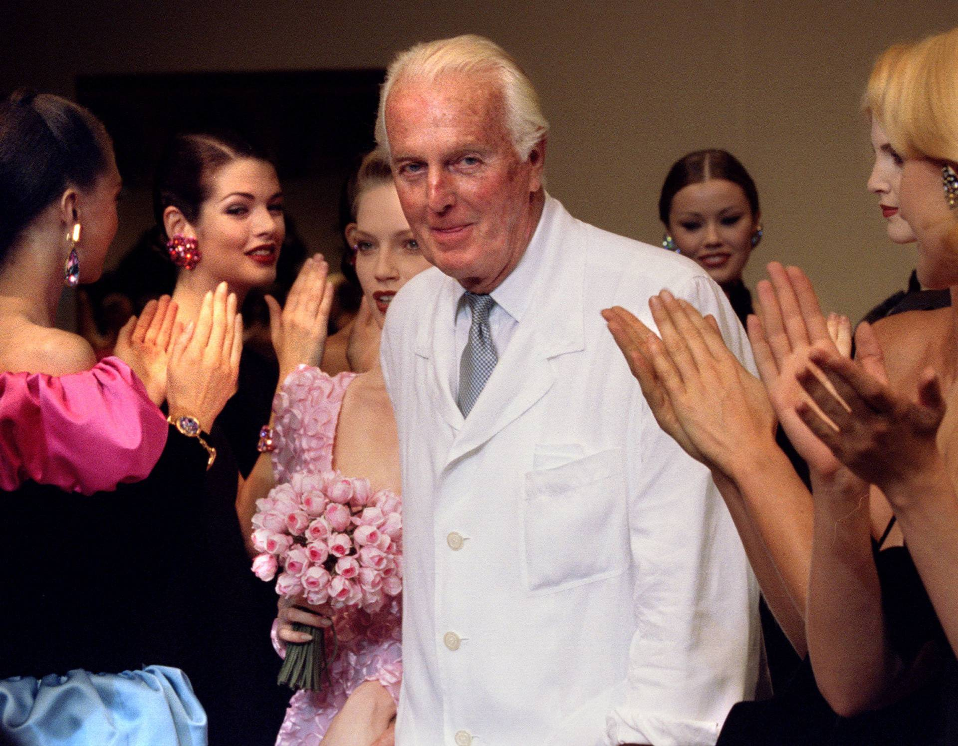 FILE PHOTO: French fashion designer Hubert de Givenchy is applauded by the models after he presented his last High Fashion collection Autumn/Winter 1995 in Paris