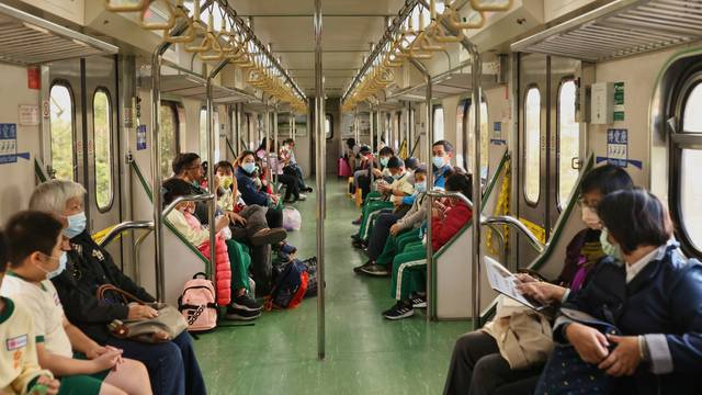 People wear protective masks to prevent the spread of the coronavirus disease (COVID-19) while taking the train in Taichung