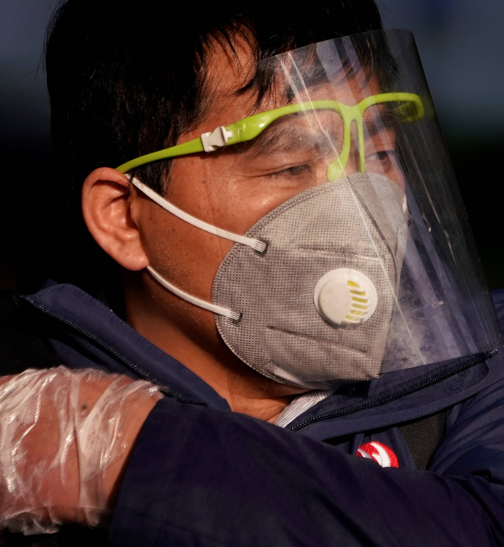 A man wearing a mask is seen at the Shanghai railway station in Shanghai