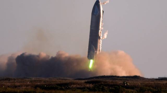 SpaceX's first super heavy-lift Starship SN8 rocket during a return-landing attempt after it launched from their facility on a test flight in Boca Chica, Texas