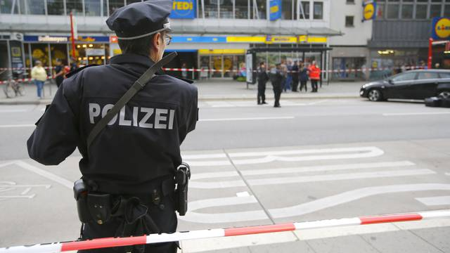 A police officer looks on after a knife attack in a supermarket in Hamburg