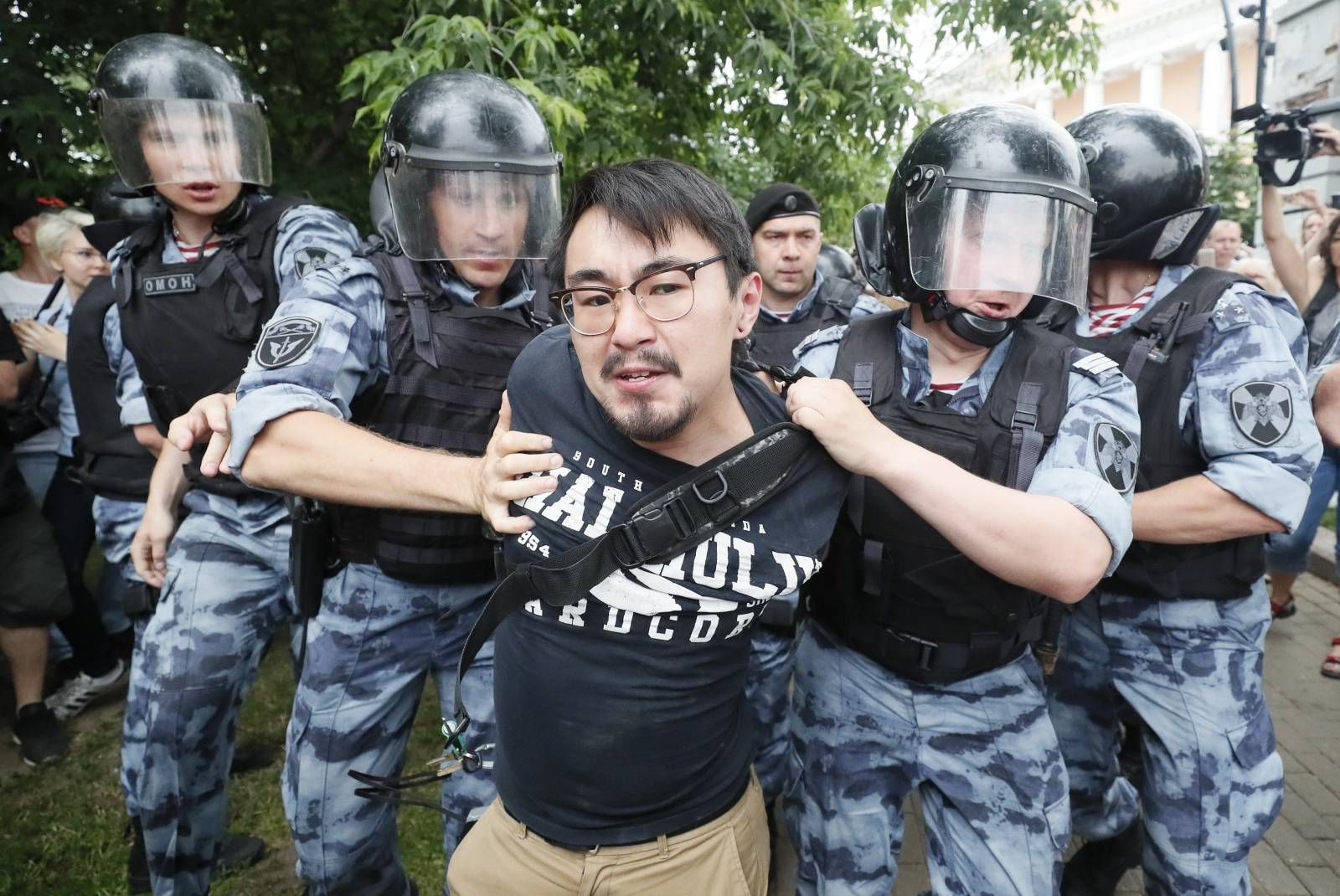 Law enforcement officers detain a participant of a rally in support of Russian investigative journalist Ivan Golunov in Moscow