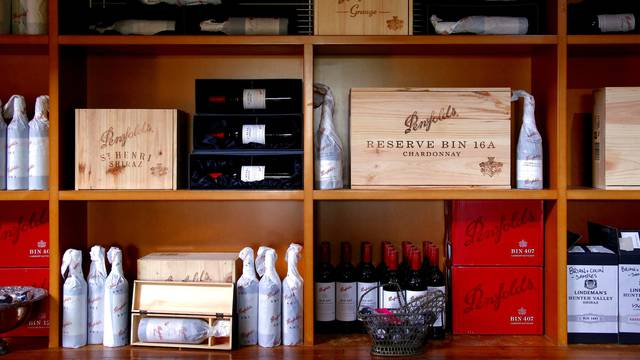 FILE PHOTO: Bottles of Penfolds Grange wine and other varieties, made by Australian wine maker Penfolds and owned by Australia's Treasury Wine Estates, sit on shelves for sale at a winery located in the Hunter Valley, north of Sydney