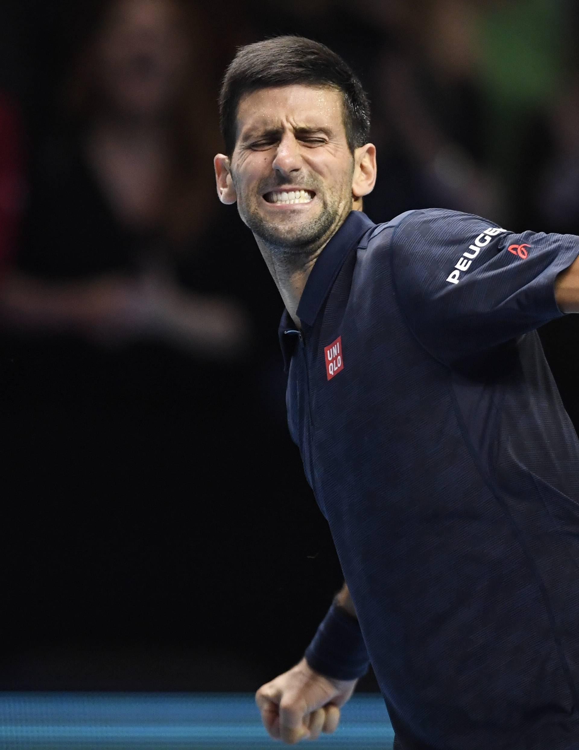 Serbia's Novak Djokovic celebrates winning his round robin match with Austria's Dominic Thiem