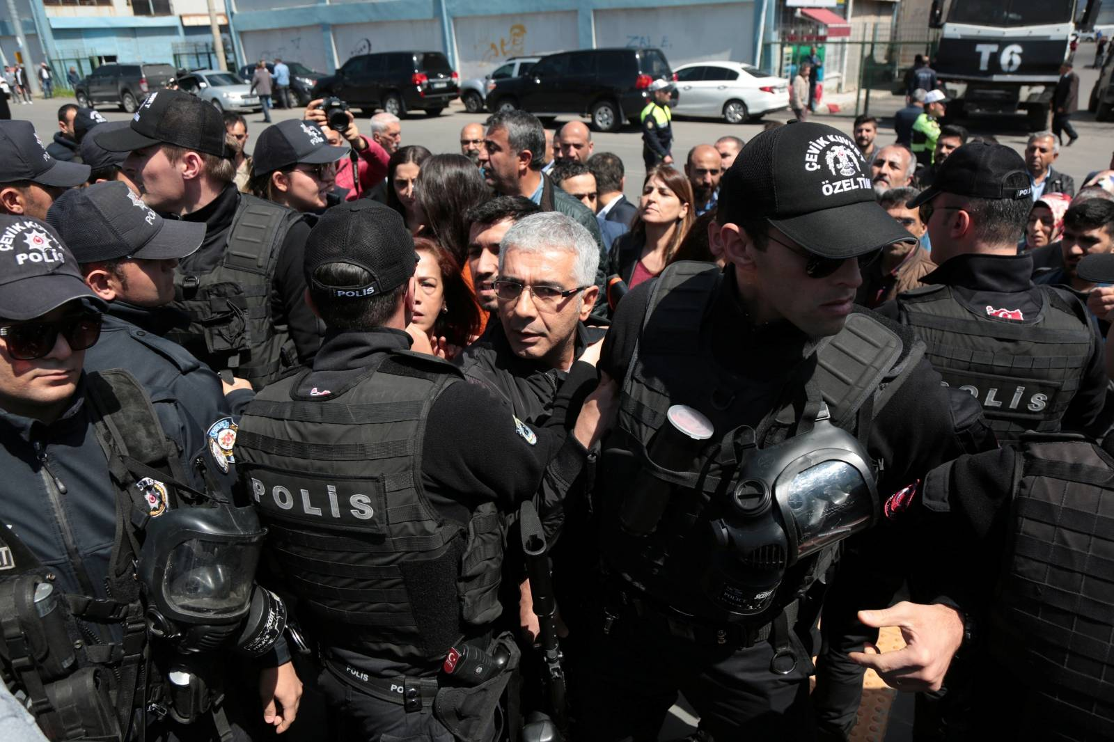 Turkish riot police prevent supporters of pro-Kurdish HDP to gather outside Baglar Municipality to protest against YSK in Diyarbakir