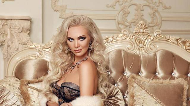 Sexy woman in luxury interior. Beautiful stunning blond in linge