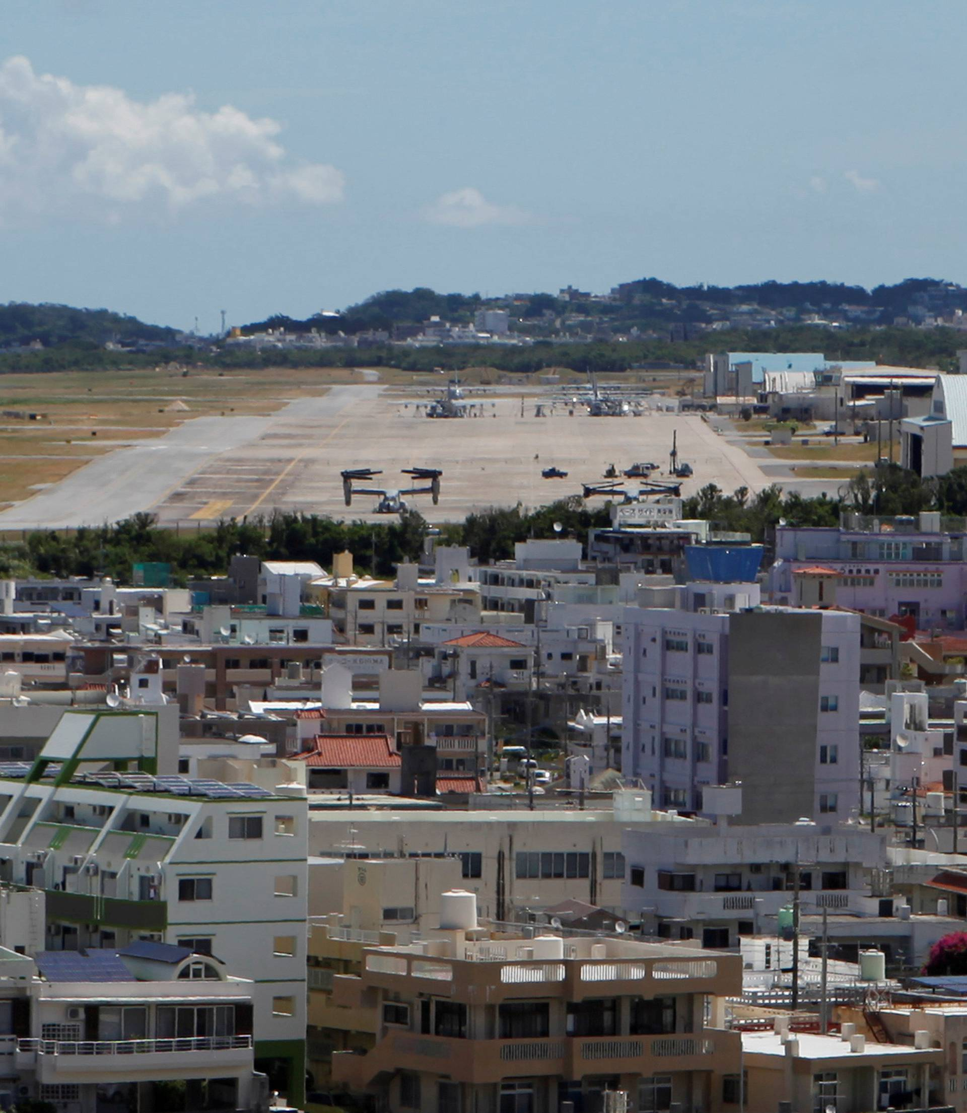 Osprey military aircraft are seen at the U.S. Futenma airbase in Ginowan